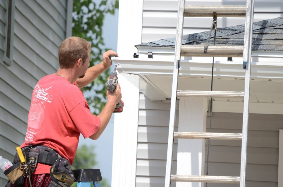 GutterShutter installer on ladder